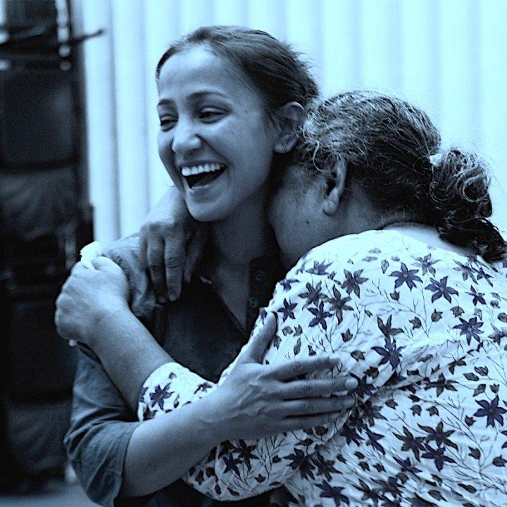 Amina Khayyam with a participant during Inter-Action