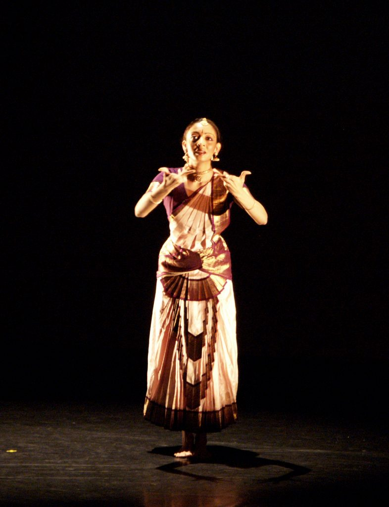 South Asian performer on stage