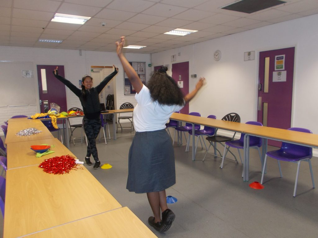 Young people taking part in a dance workshop