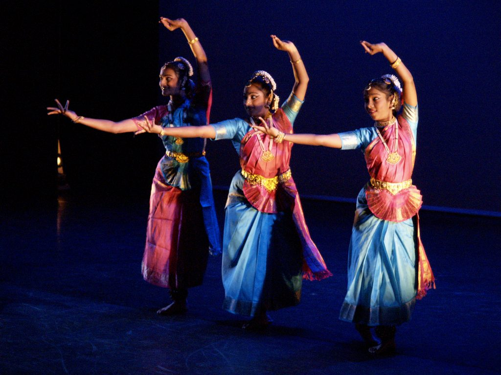South Asian performers on stage