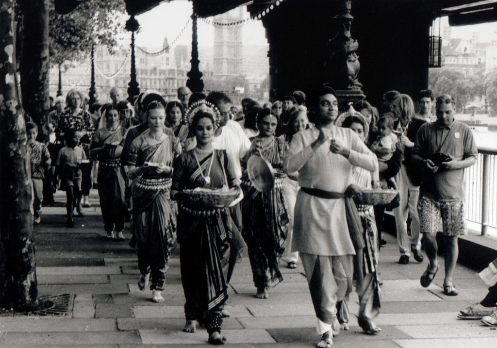 Procession of dancers walk along Southbank