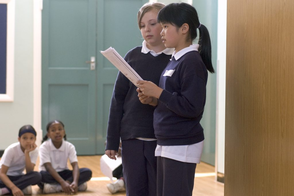 Primary school students participating in a workshop